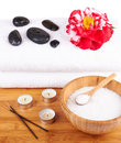 Spa setting candles flower towel salt stones over white background Royalty Free Stock Photos