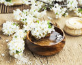 Spa Setting with Flower Blossom in Wooden Water Bowl Royalty Free Stock Photo