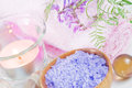 Spa setting with lilac flowers bath salts and a candle Royalty Free Stock Photos
