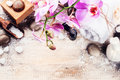 Spa setting with pink orchid, natural soap, herbal massage ball Royalty Free Stock Photo