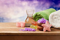 Spa setting with soap and towels on wooden table over bokeh background dreamy Royalty Free Stock Photography
