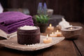 Spa setting and wellness with natural bath salt candles towels and flower wooden dayspa nature set Royalty Free Stock Image