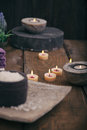 Spa setting and wellness with natural bath salt candles towels and flower wooden dayspa nature set Royalty Free Stock Photos