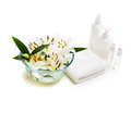 Spa sitting lily with massage oil and towel Royalty Free Stock Photo