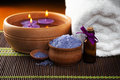 Spa still life with aromatic candles,orchid flower and towel. Royalty Free Stock Photos