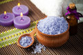Spa still life with aromatic candles and towel lavender bath salt flower Royalty Free Stock Photos