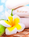 Spa still life beautiful on the beach stones yellow frangipani flower tropical resort summer holiday dayspa exotic treatment Royalty Free Stock Image