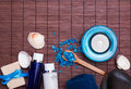 Spa still life in blue colors with bottles, soap and sea salt Royalty Free Stock Photo