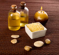 Spa still life candle bath salt bath oil stones brown bamboo background Royalty Free Stock Photo