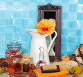Spa still life with hibiscus flower in a jug beautiful exotic orange against turquoise blue tiles burning candle rose Royalty Free Stock Image
