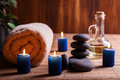 Spa still life with hot stones and candles essential oil Stock Photos