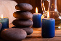 Spa still life with hot stones and candles essential oil Stock Photography