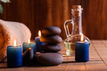 Spa still life with hot stones and candles essential oil Stock Image