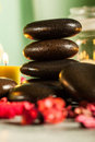 Spa still life with hot stones and candles essential oil dark tone Royalty Free Stock Images