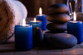 Spa still life with hot stones essential oil and candles dark tone Stock Photography