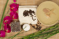 Spa still life with orchid candle coffee beans towel bamboo a on a mat Stock Image