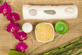 Spa still life with Orchid, candle, salt and towel  bamboo Royalty Free Stock Photo