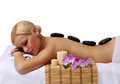 Spa Stone Massage. Blonde Woman Royalty Free Stock Photo