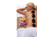 Spa stone massage blonde woman getting stones massage beautiful hot isolated on white beauty treatments Royalty Free Stock Photo