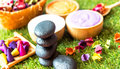Spa Thai setting for aroma therapy and sugar and salt massage, rock spa with flower on the bed, relax and healthy care. Royalty Free Stock Photo