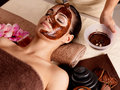 Spa therapy for woman receiving cosmetic mask young receving at beauty salon indoors Stock Photography