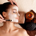 Spa therapy for woman receiving facial mask Stock Photo