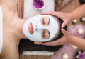 Spa therapy for young woman having facial mask at beauty salon Royalty Free Stock Photo