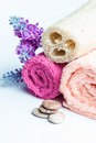 Spa towels rolls, flower and stones. Royalty Free Stock Photo