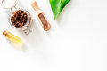 Spa treatment. Coffee scrub on white background top view copyspace