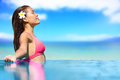 Spa vacation retreat woman relaxing at travel resort luxury happy blissful asian young in bikini in meditation enjoying Stock Photos