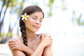 Spa wellness beach beauty woman relaxing with eyes closes on hawaii beautiful serene and peaceful young mixed race asian Royalty Free Stock Image