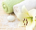 Spa with a white lily towel sea salt Stock Photo