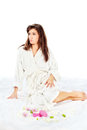 Spa woman in bathrobe relaxed isolated on white background Stock Photo