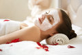 Spa Woman. Beautiful Woman Relaxes on Bed . Royalty Free Stock Photo