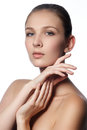 Spa woman natural beauty face beautiful girl touching her face perfect skin skincare young skin manicured nails cosmetics makeup Stock Photography