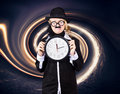 Space astronomer getting sucked into a black hole astronomy scientist holding frozen clock when out of time conceptual Royalty Free Stock Photo