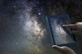 Space Astronomy Exploration Concept. Night Sky tablet Milky Way Royalty Free Stock Photo