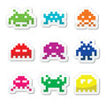 Space invaders bit aliens icons set vector labels of pixelated isolated on white Royalty Free Stock Photo