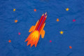 Space rocket illustration with colored pencils in space with stars background