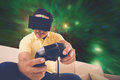 Space simulation game man in vr glasses playing Royalty Free Stock Image