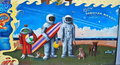Spacemen and alien graffiti art colorful by the sea with the sun abstract design Stock Image