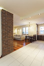 Spacious apartment living room with brick wall Stock Photo