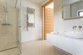 Spacious modern bathroom white with floor level shower arrangement Stock Photo