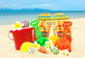 Spade and other toys on tropical beach Royalty Free Stock Photography