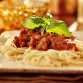 Spaghetti with basil garnish and tomato sauce close up photo of a plate of Stock Image