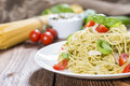 Spaghetti with basil pesto parmesan cheese and tomatoes Stock Photography