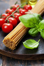 Spaghetti, basil and tomatoes Royalty Free Stock Photo