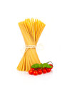 Spaghetti basil tomatoes bunch of with and cherry on white background Stock Photography