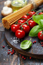 Spaghetti basil and tomatoes with herbs on an old vintage wooden table Royalty Free Stock Photos