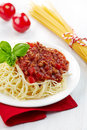 Spaghetti bolognese and green basil leaf on white plate Stock Photography